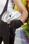 picture of partially clothed  - composite image of female bike athlete holding protection helmet against natural background - JPG