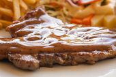 foto of pork cutlet  - pork chop steak with black pepper gravy salad and french fries - JPG
