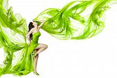 image of flutter  - Woman dancing in green dress beautiful fluttering and waving fabric isolated white background - JPG