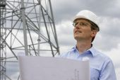 foto of oil drilling rig  - Engineer with blueprint in front of crane - JPG
