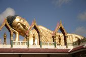 foto of recliner  - Reclining Buddha on top of Thai Temple - JPG