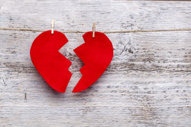 foto of heartbreaking  - Broken heart hanging on rope - JPG