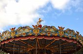 stock photo of carousel horse  - a golden horse on the top of a carousel - JPG