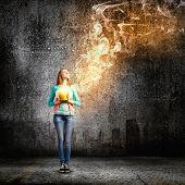 stock photo of fumes  - Young girl holding bucket with flying out fume - JPG