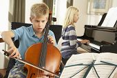 image of cello  - Boy and girl playing cello and piano at home - JPG