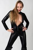 foto of catsuit  - Beautiful slender blonde in a black latex catsuit - JPG