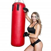 stock photo of heavy bag  - Sexy blonde woman with heavy bag boxing isolated on white - JPG