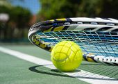 stock photo of balls  - Close up view of tennis racket and balls on the clay tennis court - JPG