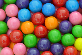 stock photo of gumballs  - Multi colored gumballs to use as background - JPG
