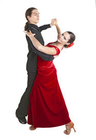 pic of waltzing  - Young couple dancing waltz isolated over white background - JPG