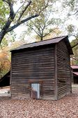 stock photo of tobacco barn  - Vinatge old fashioned tobacco barn on a farm - JPG