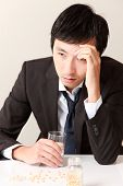 stock photo of mutilated  - middle aged Japanese businessman suffers from a neurosis - JPG