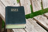 picture of bible verses  - Holy Bible closeup on old wood seat - JPG