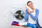 pic of dirty-laundry  - Young housewife is doing laundry with washing machine at home - JPG