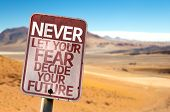 stock photo of strength  - Never Let Your Fear Decide your Future sign with a desert background - JPG