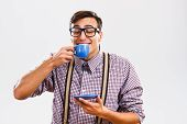 picture of nerd  - Photo of funny nerd guy enjoys drinking coffee - JPG
