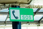 foto of sos  - SOS sign was mounted on a pole - JPG
