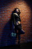 picture of hooker  - portrait of girl dressed like hooker posing near brick wall - JPG