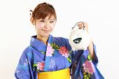 foto of mosquito repellent  - Young woman wearing Japanese kimono with mosquito coil - JPG