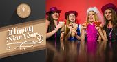 picture of hen party  - Laughing friends having hen party holding cocktails against classy new year greeting - JPG