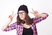 image of beanie hat  - Cute hipster teenage girl with beanie hat posing looking at camera - JPG