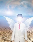 image of surrealism  - Winged figure with obscured face in surreal landscape Elements of this image furnished by NASA - JPG