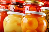 picture of jar jelly  - Jars with fruity compotes jams and pickled vegetables - JPG
