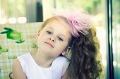 foto of hair bow  - little girl with a pink bow with long hair on a blurred background - JPG