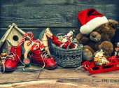 picture of nostalgic  - nostalgic christmas decoration with antique toys over wooden background - JPG