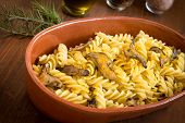 image of mullet  - dish of italian pasta stuffed with mushrooms and bottarga, dried mullet roe ** Note: Shallow depth of field - JPG