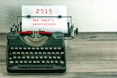 picture of toned  - Typewriter with white paper page on wooden table - JPG