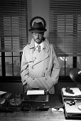 picture of 1950s style  - Attractive detective standing next to his desk 1950s style office - JPG