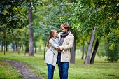 image of amor  - Amorous man and woman spending leisure in summer park - JPG