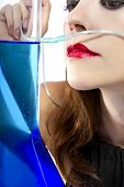 image of inhalant  - woman inhaling flavored oxygen with cannula and scented water - JPG