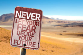 picture of future  - Never Let Your Fear Decide your Future sign with a desert background - JPG