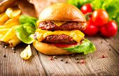 image of french fries  - Hamburger with fries on wooden table - JPG