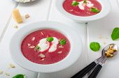 foto of beet  - Soup from beet with light creame nuts and basil sprinkled organic beet - JPG