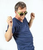 image of rap  - smart man performs a cool rap dance with green sunglasses - JPG