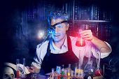 picture of scientist  - Portrait of a crazy medieval scientist working in his laboratory - JPG