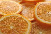 foto of valencia-orange  - background made of few sliced juicy oranges - JPG