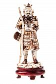 stock photo of ivory  - an ancient precious ivory japanese samurai warrior figurine isolated over a white background - JPG