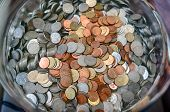 picture of copper coins  - plenty of Thai coins in glass bucket - JPG