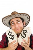 stock photo of wrangler  - Young cowboy with money bags isolated on white - JPG
