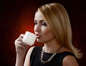 picture of bitchy  - Young attractive woman with cup of coffee - JPG