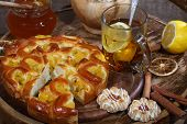 stock photo of peach  - Tea submitted with a pie with a peach stuffing with honey and cookies - JPG