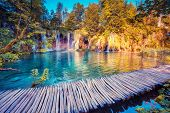 stock photo of breathtaking  - Majestic view on turquoise water and sunny beams in the Plitvice Lakes National Park - JPG