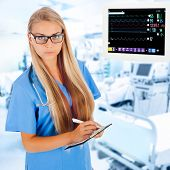 pic of icu  - Young female doctor writing prescription in ICU with medical equipment on background - JPG