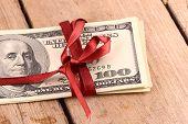 stock photo of bundle  - Bundle of dollars tied with ribbon - JPG