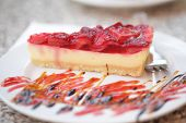pic of cheesecake  - Cheesecake with strawberry jelly on a plate - JPG