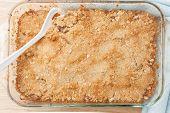 picture of crisps  - top view of fresh homemade apple crisp in glass baking dish - JPG